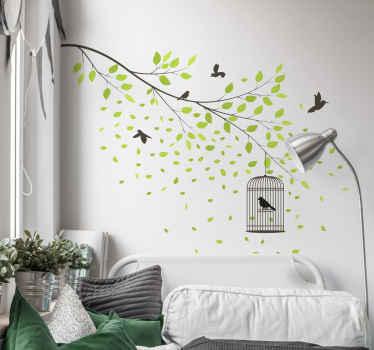 Pássaros voadores decorativos no vinil autocolante decorativo da árvore. No desenho são vistos pássaros negros pairando ao redor das folhas verdes de um galho de árvore.