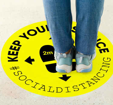 Social distancing floor sign sticker design made on a round yellow background surface with warning text. Recommended for hospitals and  public places.