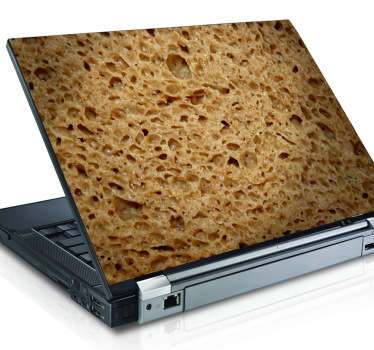 An unusual and quirky laptop decal with a close up photo of some bread.