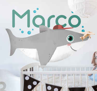Illustrative baby shark fish sticker ideal to decorate the room of children. The fish is depicted to be under water with air bubbles from it breath.