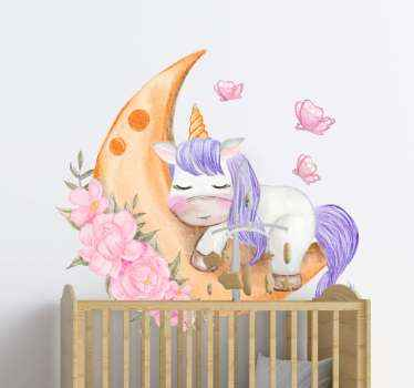 A baby unicorn illustration sticker. The unicorn is illustrated to be sleeping on a half moon with pretty flower and butterflies designed around it.