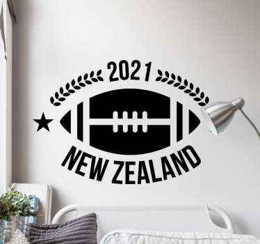 Rugby wall art decal design illustrated with a rugby ball and inscription that reads ''2021 New Zealand.  The colour is customizable and it is durable.