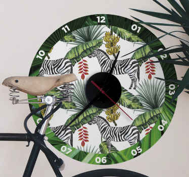 Nature pattern wall clock sticker for a living room, bedroom and other spaces. The clock surface is designed with palm leave patterns with zebras.