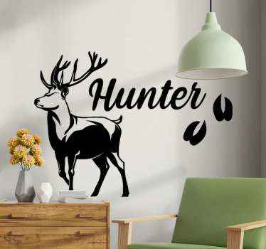 Enhance the look of any space with a unique look with this modern hunting wallpaper, A deer illustrated with footprints with the word hunter