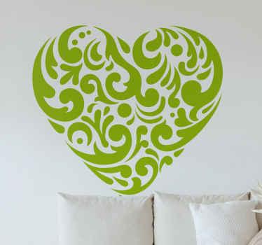 Decora il tuo spazio con questa originale decalcomania da muro a forma di cuore con motivi ornamentali. Puoi personalizzare il colore e le dimensioni.