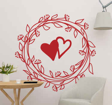 Una decalcomania da muro con ghirlanda di foglie e cuore con opzioni di colore personalizzabili. Può essere applicato su qualsiasi superficie piana.