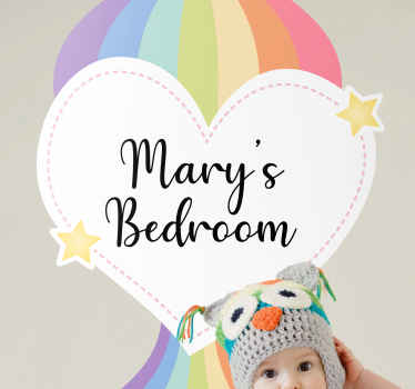 Personalised wall decal with the image of a heart and a rainbow hot air balloon and customizable name to identify your child's room.