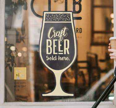 """Text sticker with illustration of a glass and the phrase """"Craft beer sold here"""" perfect for applying on the window of your store or bar restaurant."""