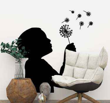 A person silhouette vinyl decal illustrated holding a dandelion. Beautiful design to decorate any space in a house and it can be customized.