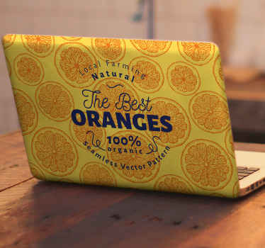 Laptop sticker which features the text 'The best Oranges, 100% organic' on a background of colourful oranges. Zero residue upon removal.