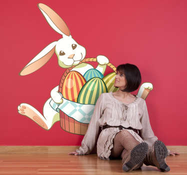 A colourful and playful design of a cheerful bunny with a basket full of eggs from our collection of rabbit wall stickers for kids.