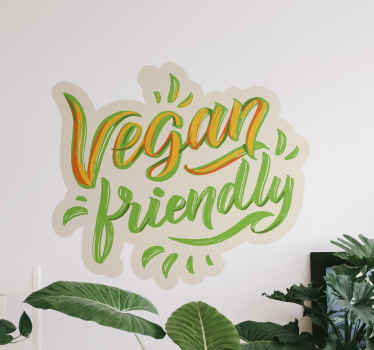 Vegan business sticker design with stylish text that reads ''Vegan friendly''.  Design for vegan restaurants, shop, home kitchen and dinning space.