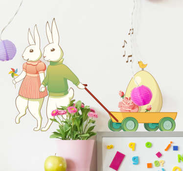 A pair of rabbits holding hands pulling a trolley with a large egg! A creative decal from our collection of bunny wall stickers for Easter!