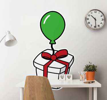 Wall decal with the illustration of a gift box with  red ribbon and a green balloon, which will fill with joy the room or space you decide to decorate