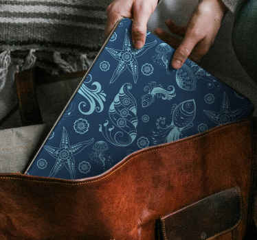 Sea life laptop skin which features a pattern of objects from under the sea such as coral, starfish, shells, jellyfish and fish.