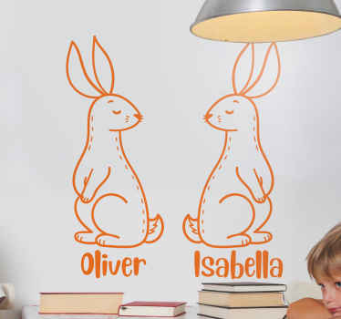 Easter wall decal which features a cute image of two Easter bunnies with your personalised name underneath. Anti-bubble vinyl.