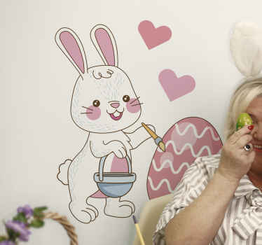 Easter bunny with egg drawing wall decal to decorate the room of your little one to brighten him or her with the fantasy of Easter holiday.