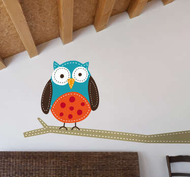 A decorative decal of an owl on a tree branch. This cool design is from our collection of owl wall stickers to give your home a new look.