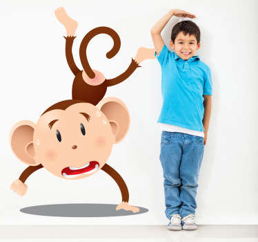 Kids Wall Stickers - Playful illustration of a monkey doing a handstand. Available in various sizes. Ideal for decorating areas for children.