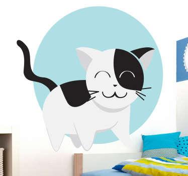 Adhesivo de un lindo felino blanco y negro sobre un fondo redondo de color azul.