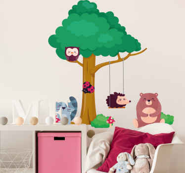 A beautiful decorative wall art decal for children bedroom illustrating a green tree with forest animals on swing on it branch.