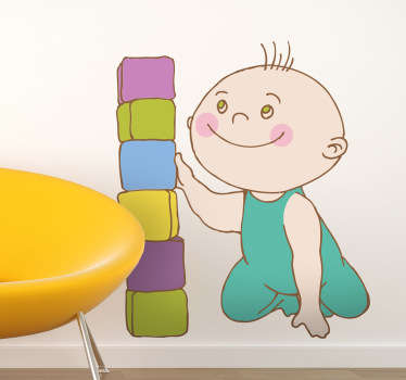 A children's wall sticker illustrating a little boy playing with coloured blocks! Colourful decal to decorate your child's playroom.