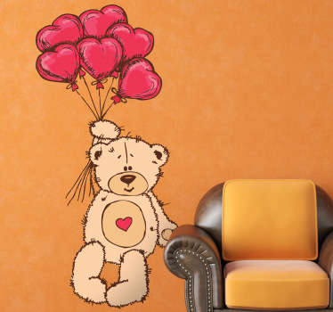 Kids wall sticker of a teddy bear flying through the air holding onto six heart-shaped balloons from our collection of heart stickers. If you are looking for similar designs then make sure you also check our teddy bear wall stickers!
