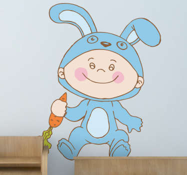 A cute design illustrating a little boy wearing a blue bunny costume and holding a carrot. Decal from our collection of rabbit wall stickers.