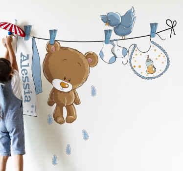 A wall sticker with an illustration of a washing line with several baby related items pegged onto it. Ideal for decorating babies nurseries.