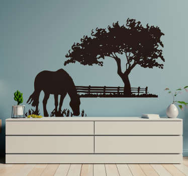 A silhouette illustration of a horse in a meadow. Striking distinctive horse wall art decal for your home or business.