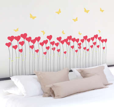 Heart shape flowers under fluttering butterflies from our collection of heart wall stickers to decorate your wall!