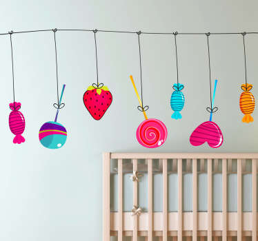 A great children's wall sticker illustrating various sweets and treats hanging from a line. Lollipops, strawberries and more!