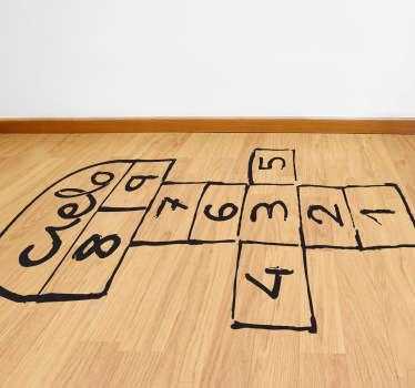 Wall sticker che raffigura lo schema del celebre gioco campana, detto anche gioco del mondo, che ha fatto divertire generazioni intere di bambini.
