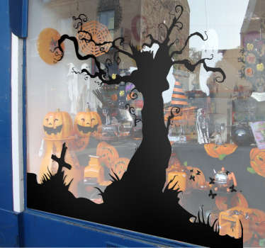 Terrorífico adhesivo con la silueta de un árbol y la lápida de una tumba para los niños que disfrutan en halloween.