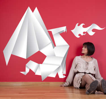 Original adhesivo con la forma de un temible dragón escupiendo fuego pero hecho con papel plegado.