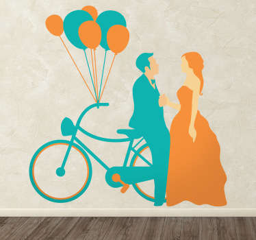From our collection of wedding inspired wall stickers, a silhouette design of a recently married man and woman next to a bike.