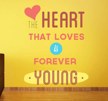 """The heart that loves is forever young"" is a colourful text design from our collection of heart wall stickers."