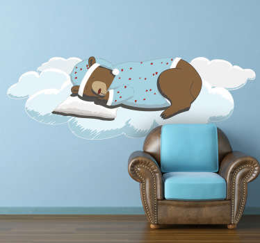 An illustration of an adorable bear wearing pyjamas sleeping on a cloud from our superb collection of cloud wall stickers for children. This is the ideal design to decorate the bedroom or play area of the little ones. Create a fun environment where they can have fun during playtime.