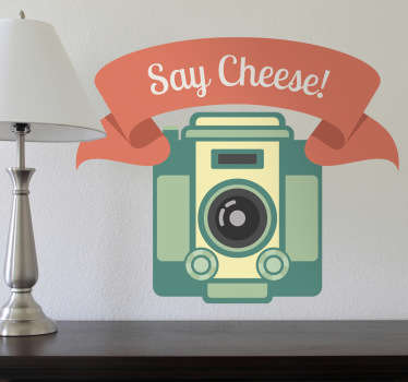 "Vintage decal illustrating a camera and ""say cheese"" banner. Fantastic design from our collection of retro wall stickers to personalise your place!"