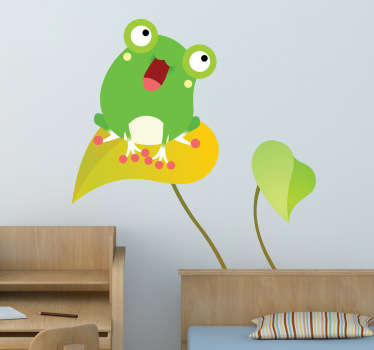 Muursticker van een groene kikker dat gehurkt zit op een blaadje. Een mooie wandsticker voor de decoratie van de slaapkamer, badkamer of kinderkamer.
