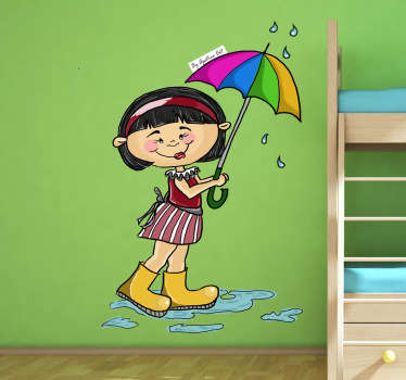 A colourful wall sticker displaying a little girl walking home holding an umbrella to protect herself from the rain.