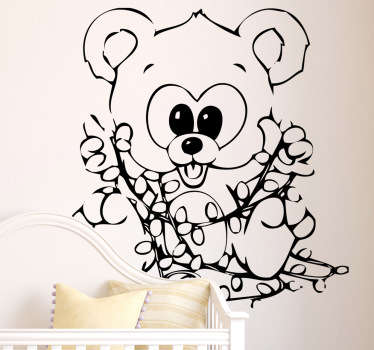 A cute children's sticker of a happy looking bear playing with some Christmas fairy lights.