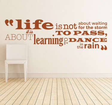 "Sticker con la frase della famosa scrittrice  Vivian Greene, ""Life is not about waiting for the storm to pass, about learning to dance in the rain""."