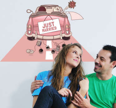 A fun sticker showing a newly-wed couple driving away in a pink pastel coloured car.