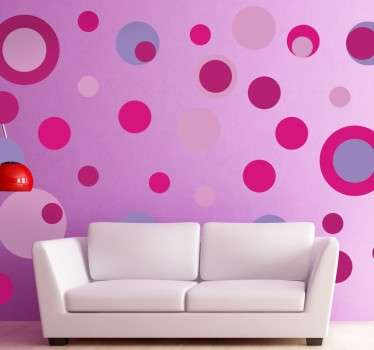 Collection of circle stickers with different sizes and pink and purple colours.