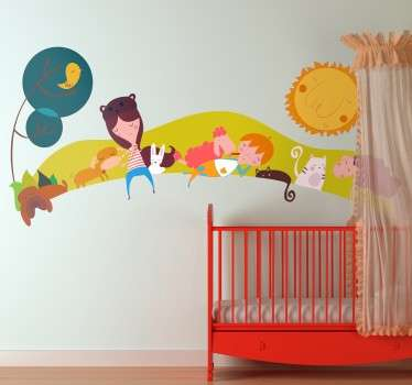 Children's wall decal with an image of a meadow and several children accompanied by animals.