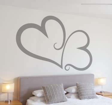 Wall sticker decorativo che raffigura due cuori tribali stilizzati. Idea decoro per la tua testiera.