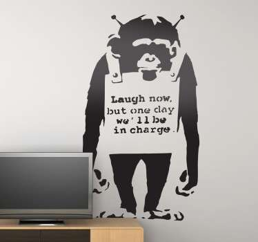 "Sticker texte ""Laugh now, but one day we'll be in charge"", célèbre dessin du mystérieux artiste urbain Banksy."