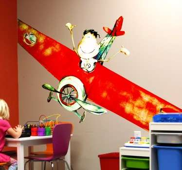 An impressive and colourful wall decal by illustrator Lol Malone of a happy little boy waving from a red airplane.