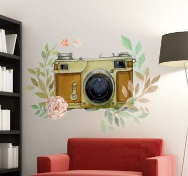 A beautiful wall decal that combines an old vintage camera with a floral ornamental decoration.
